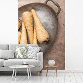 Fotobehang vinyl - Zes organische pastinaken op een grijze plateau breedte 215 cm x hoogte 320 cm - Foto print op behang (in 7 formaten beschikbaar)