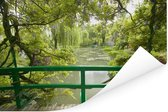 Uitzicht op het water vanaf de Japanse brug in Monet's tuin in het Franse Giverny Poster 90x60 cm - Foto print op Poster (wanddecoratie woonkamer / slaapkamer)
