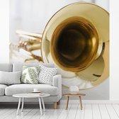 Fotobehang vinyl - Een close up van een gouden trompet breedte 280 cm x hoogte 280 cm - Foto print op behang (in 7 formaten beschikbaar)