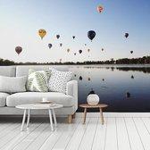 Fotobehang vinyl - Hete luchtballonnen tijdens een zonsopgang breedte 350 cm x hoogte 260 cm - Foto print op behang (in 7 formaten beschikbaar)