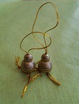 Set van 25 vrolijke boeddha's om cadeautjes mee te versieren.