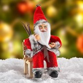 Kerstman op bankje
