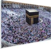 De Kaäba moskee met een aantal biddende moslims Plexiglas 120x80 cm - Foto print op Glas (Plexiglas wanddecoratie)