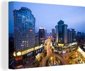 Aziatische stad Guiyang in de schemering Canvas 180x120 cm - Foto print op Canvas schilderij (Wanddecoratie woonkamer / slaapkamer) XXL / Groot formaat!
