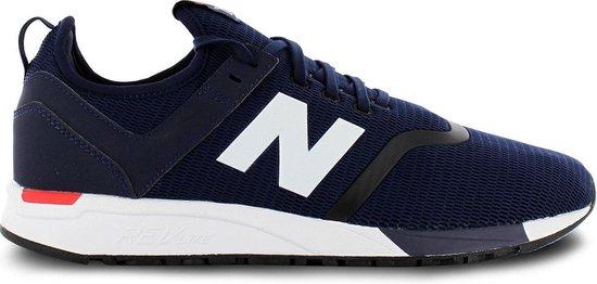 bol.com | New Balance 247 Sneakers - Maat 42 - Mannen - navy/wit