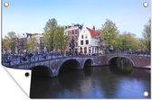 De Keizersgracht in Amsterdam onder een blauwe lucht 120x80 cm