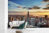 Fotobehang vinyl - Indrukwekkende lucht boven het Empire State Building in Amerika breedte 450 cm x hoogte 300 cm - Foto print op behang (in 7 formaten beschikbaar)