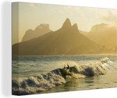 Golven op het Braziliaanse strand van Ipanema tijdens een zonsopkomst Canvas 60x40 cm - Foto print op Canvas schilderij (Wanddecoratie woonkamer / slaapkamer)