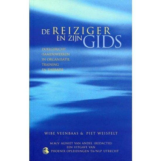 Boek cover De reiziger en zijn gids van Wibe Veenbaas (Onbekend)