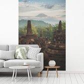 Fotobehang vinyl - Fantastisch uitzicht over de jungle vanaf de Borobudur breedte 180 cm x hoogte 270 cm - Foto print op behang (in 7 formaten beschikbaar)