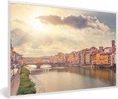 Foto in lijst - Zonnestralen over de Ponte Vecchio in Italië fotolijst wit 60x40 cm - Poster in lijst (Wanddecoratie woonkamer / slaapkamer)