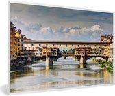 Foto in lijst - Donkere wolkenformatie boven de Ponte Vecchio in Florence fotolijst wit 60x40 cm - Poster in lijst (Wanddecoratie woonkamer / slaapkamer)