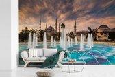 Fotobehang vinyl - Fontein voor de blauwe moskee in Istanbul Turkije breedte 420 cm x hoogte 280 cm - Foto print op behang (in 7 formaten beschikbaar)