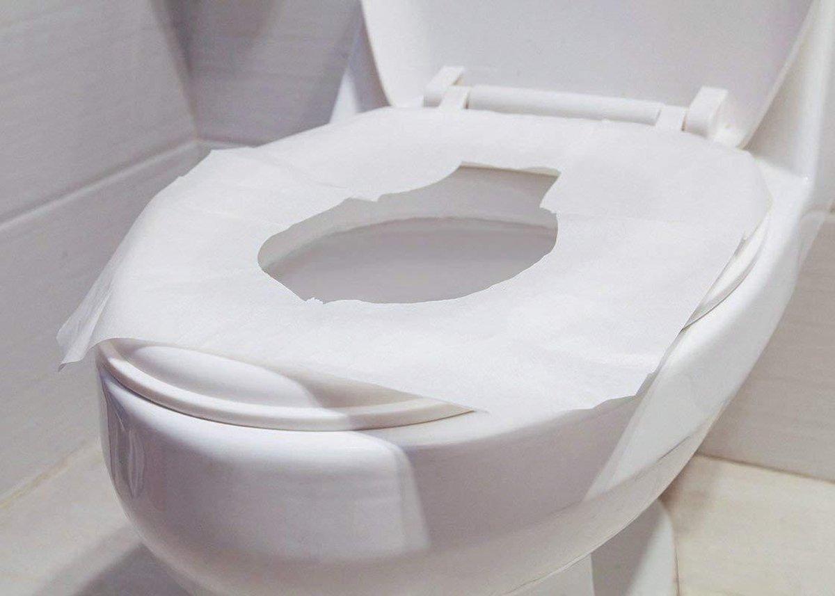 Verpakt per 100 stuks - Toilet Seat Cover papier - 100% recycled hygi nisch papier - 100% doorspoelb