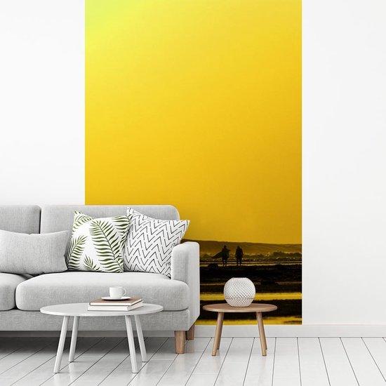 Fotobehang vinyl - Zonsondergang bij het Nationaal park Alas Purwo in Oceanië breedte 210 cm x hoogte 320 cm - Foto print op behang (in 7 formaten beschikbaar)