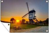 Zonsondergang boven een historische windmolen tuinposter los doek 120x80 cm - Tuindoek / Buitencanvas / Schilderijen voor buiten (tuin decoratie)
