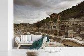 Fotobehang vinyl - Donkere wolken boven de RuÏnes van Efeze in Turkije breedte 540 cm x hoogte 360 cm - Foto print op behang (in 7 formaten beschikbaar)