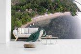 Fotobehang vinyl - Luchtfoto van de kustlijn bij het boslandschap van het Nationaal park Alas Purwo breedte 605 cm x hoogte 340 cm - Foto print op behang (in 7 formaten beschikbaar)