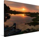 Zonsondergang aan het water bij de Pantanal Canvas 140x90 cm - Foto print op Canvas schilderij (Wanddecoratie woonkamer / slaapkamer)