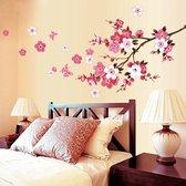 Muursticker met tak, roze bloemen en vlinders