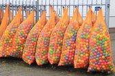 Grote oranje netzakken met trekband - 140 x 90 cm - 10 stuks