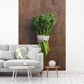 Fotobehang vinyl - Een bos van broccoli samengebonden met touw breedte 240 cm x hoogte 360 cm - Foto print op behang (in 7 formaten beschikbaar)