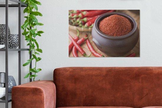 Gepoederde cayennepeper in een bakje Canvas 60x40 cm - Foto print op Canvas schilderij (Wanddecoratie woonkamer / slaapkamer)