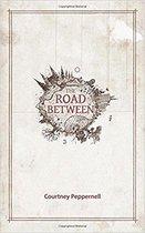 Boek cover The Road Between van Courtney Peppernell (Paperback)