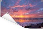 Een kleurrijke zonsondergang bij de zee Tuinposter 180x120 cm - Tuindoek / Buitencanvas / Schilderijen voor buiten (tuin decoratie) XXL / Groot formaat!