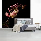Fotobehang vinyl - Een kersenbloesem tegen een zwarte achtergrond breedte 300 cm x hoogte 300 cm - Foto print op behang (in 7 formaten beschikbaar)