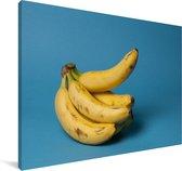 Oudere tros bananen op donkerblauwe achtergrond Canvas 60x40 cm - Foto print op Canvas schilderij (Wanddecoratie woonkamer / slaapkamer)