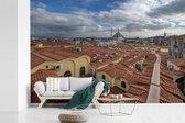 Fotobehang vinyl - Uitzicht over de daken van huizen in Istanbul breedte 450 cm x hoogte 300 cm - Foto print op behang (in 7 formaten beschikbaar)