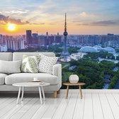 Fotobehang vinyl - Kleurrijke zonsondergang in het Aziatische Foshan breedte 360 cm x hoogte 270 cm - Foto print op behang (in 7 formaten beschikbaar)
