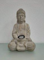 Boeddha beeldje met verlichting